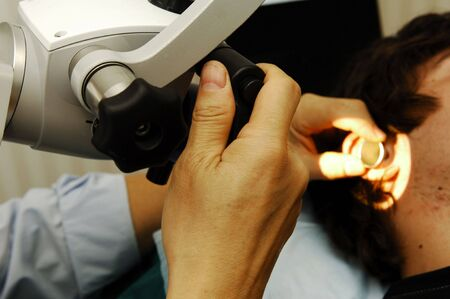 Otolaryngology examination; medical examen in a specialize clinic   Stock Photo