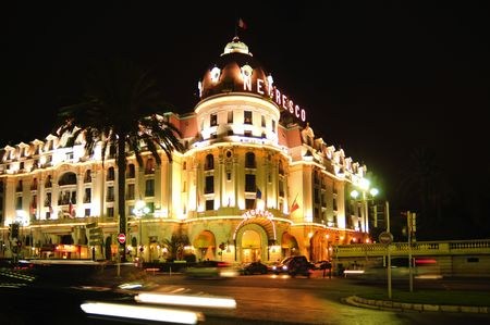 France, Nice: The French Riviera famous places. A night view of the ancient and famous hotel Negresco Foto de archivo