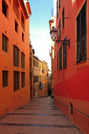 France, Nice: The French Riviera famous places. View of a typical old architecture with traditional colors photo