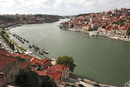 main river: Portugal, Porto; view of the ancient city with is main river, the Douro and the sunroofs of the famous oporto wine caves.  Stock Photo