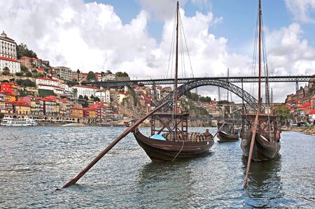 main river: Portugal, Porto; view of the ancient city with is main river, the Douro and the famous oport wine boats. On the background the bridge Eiffel or D.Luis