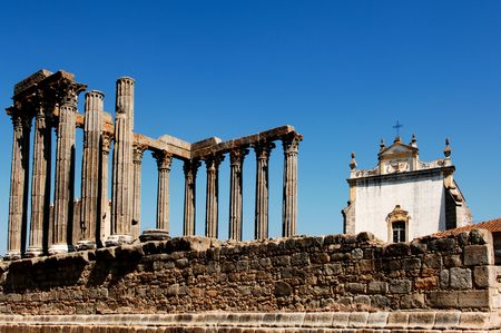 Portugal, Alentejo, Evora: Temple of Diana; the temple was constructed in the first century AD in honour of emperor august; an open square today fronted by the cathedral and the bishops house; view of the columns and podium photo