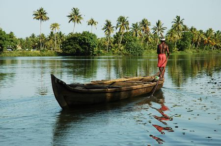 India, Kerala: landscape with a traditional boat in the backwater