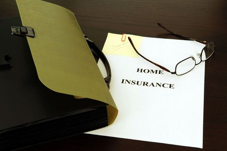 preparing the insurance file; key, glasses and papers photo