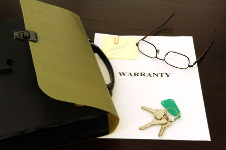 committed: Warranty file. Keys, glasses and papers
