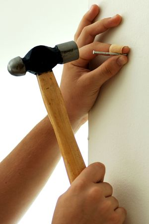 doityourself: Do-it-yourself, hanging with a hammer Stock Photo