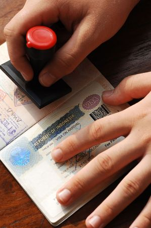 Immigration control; mark by stamping a passeport Stock Photo - 3571394