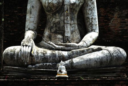 ajana: Thailand, Sukhothai or Sukothai was the capital of the Thai Empire founded in 1238.  Detail of a seated Buddha statue  at Phra Atchana or Ajana at wat Si Chum; a hand