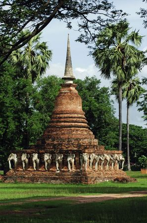 encircling: Thailand, Sukhothai or Sukothai was the capital of the Thai Empire founded in 1238. Wat Sorasak is a chedi with elephants figures encircling its base.