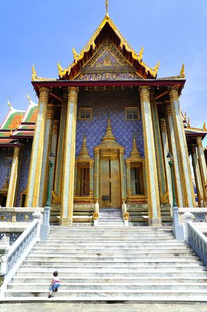 Thailand Bangkok; the wat Phra Kaew shelter the most sacred image of Thailand the Emerald Buddha. The temple is situated in the northeast corner of the Grand Palace. View of one entrance door