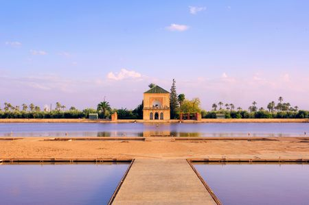 Morocco, Marrakech, Marrakesh: Menara garden; blue sky and blue waters dominated by the pond view Foto de archivo