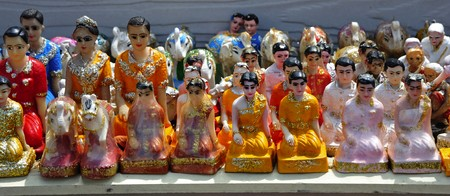 Thailand; Pattaya; view of small religious statues on the foot of the monument to the admiral Krom Jumborn near the Jomtien beach photo