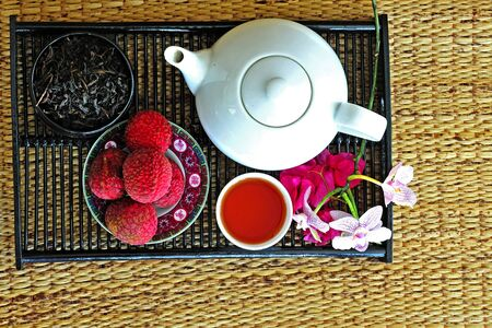 calming: Asian pottery tea  set with chinese tea and litchees