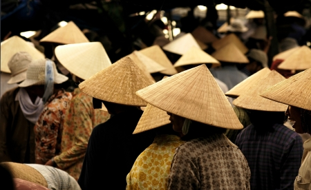 A typical view of Vietnam's market morning : women with conic hats