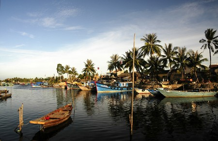 Vietnam, Hoi An: View of the harbor in the middle of the tropical vegetation