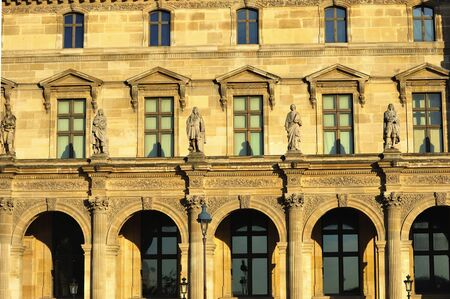 strret: France; Paris: View of the Louvres facade with the typical bronze street lamp