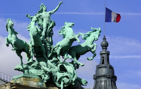 palais: France; Paris; impressive bronze sculpture on the roof of the grand palais Stock Photo