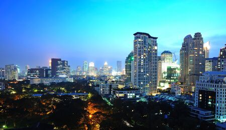 chit: Aerial city view of Bangkok at night - skyscrapers in Chit Lom area