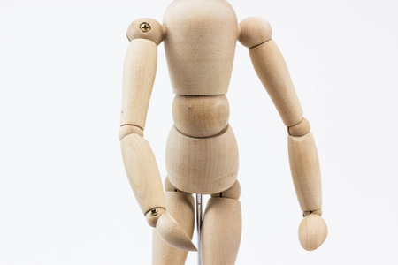 The torso and part of the legs of a wooden mannequin, on its stand, on a white background.