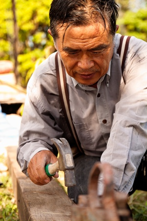 Thai construction worker in field Stock Photo