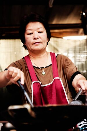 Thai woman is cooking the food