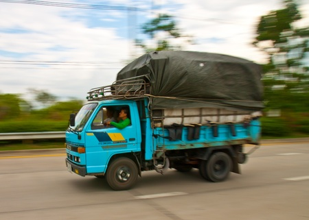 drove: Chiangmai, Thailand,- Apirl 28, 2011:The mini truck drove in the road