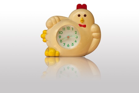 The chiken alarm clock in isolation photo