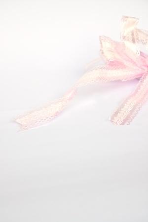 Shiny pink satin ribbon on white 写真素材
