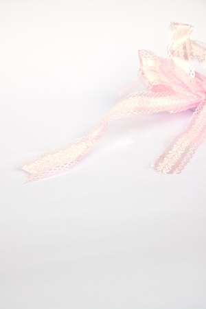 Shiny pink satin ribbon on white Stock Photo