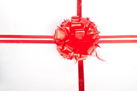 Big red holiday bow on white background Stock Photo - 10277798
