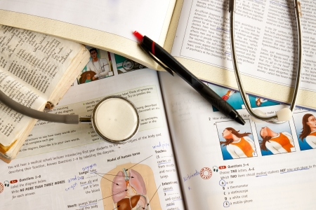 medical students: The text books and a stethoscope