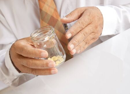 A doctor with some pills photo