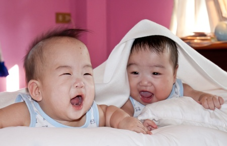 LIFESTYLE IMAGE-two lovely infants playing together