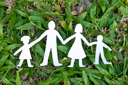 happy family in the grass Stock Photo