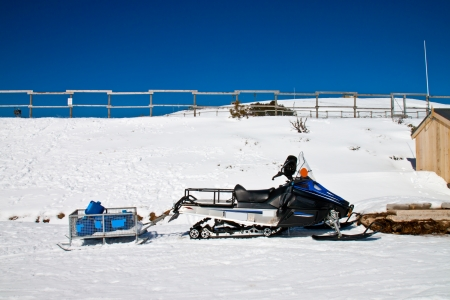 a parked snowmobile in a winter setting