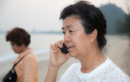 A woman is talking by phone Stock Photo