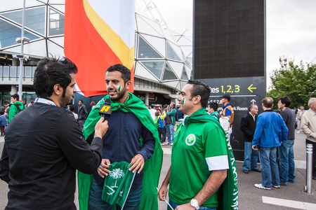 Melbourne, Australia - June 18, 2015 - AFC Asian Cup 2015 Australia - the funs of Saudi Arabia gave the interview to the reporter before game between Uzbekistan VS Saudi Arabia in the first round at rectagular stadium on 18 June 2015