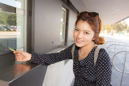 the girl with the ticket Stock Photo