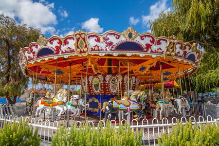 The carousel with the blue sky