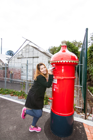 the girl with the post box Stock Photo