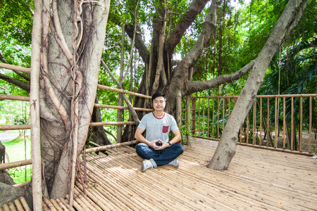 The man do meditation on the tree house, Nakhon Pathom provice, Thailand