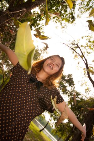 The girl with the leaves in Nakhon Pathom provice, Thailand
