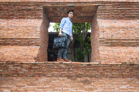 The man stands at the door of his brick style office
