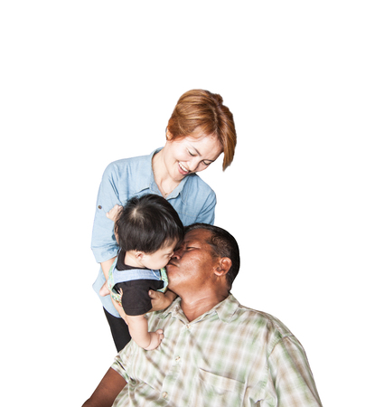 The family, with grandmother, grandfather and grandson kissing Stock Photo