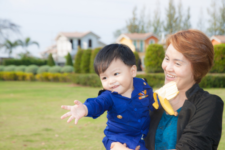 The grandson with the grandparents at the park 写真素材