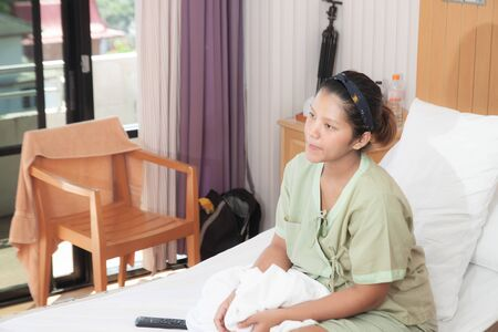 The girl in the hospital with smiley face
