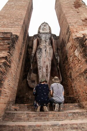 A Thai couple in the temple Sukhothai, Thailand