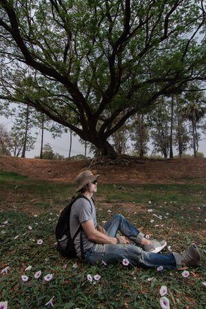 Thai man solo tralveler in the park, Sukhothai, Thailand