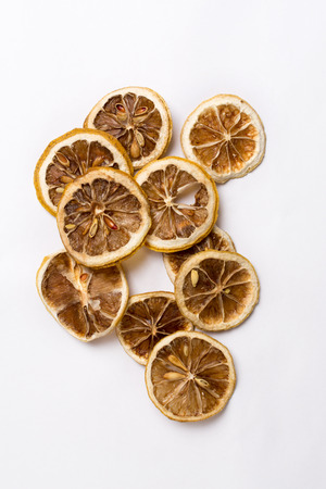 Dried lemon slices on white background