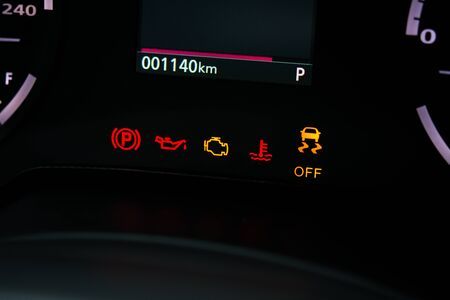 The fault light on the car dashboard is fully lit up close-up